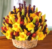If you don't think she will want the bouquet you smell, what about a nibble. From Edible Arrangements