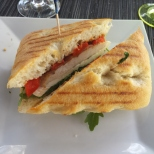 GRILLED CHICKEN PANINO Prosciutto, mozzarella, roasted peppers, basil