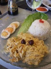 AJI DE GALLINA Shredded chicken breast cooked with cream of aji amarillo and nuts