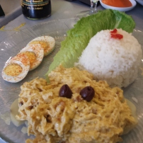 AJI DE GALLINA Shredded chicken breast cooked with cream of aji amarillo and nuts