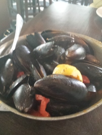 OUZO MUSSELS Sautéed with fresh roasted tomatoes, basil, garlic and ouzo