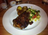 12 OZ NIMAN RANCH BONE-IN PORK CHOP Mostarda, parmesean roasted yukon potatoes, grilled zucchini